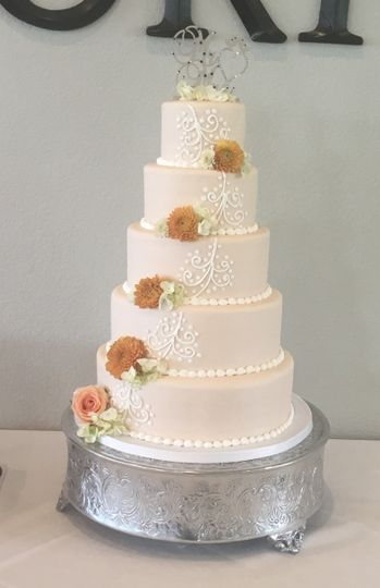 White cake with ascending flowers