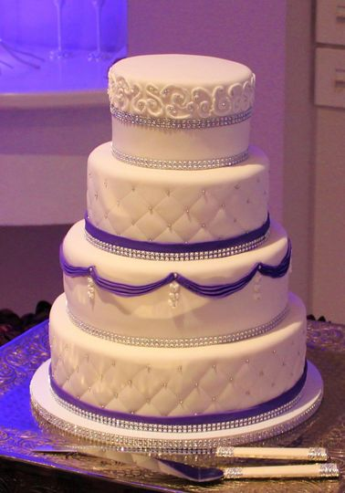 White cake with purple bands