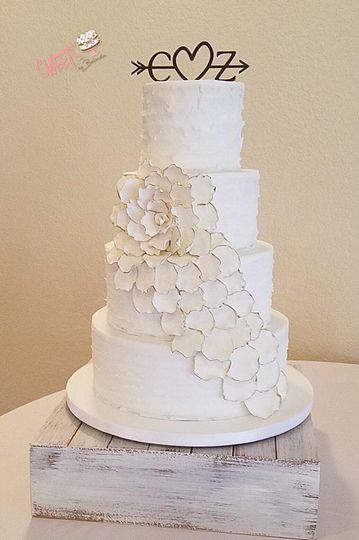 Textured white cake with flower outline design