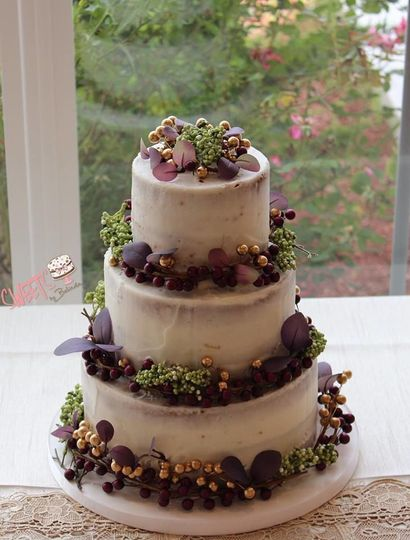 Naked cake with berry decoration on each layer