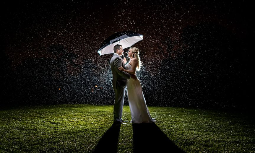 Newlyweds under the rain