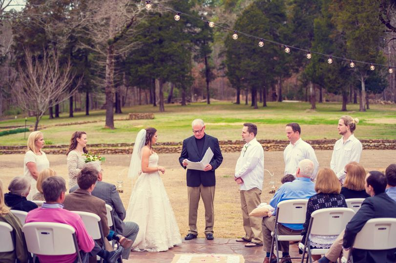 Outdoor wedding on the back patio under the lights