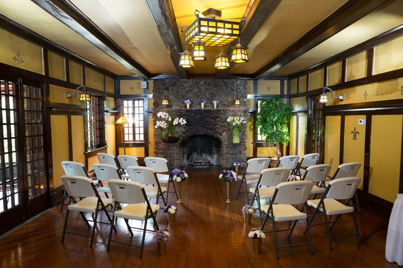 Indoor small wedding by historic fireplace.