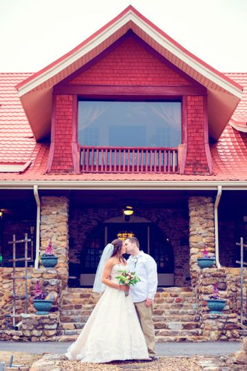 Bride and groom front of inn.