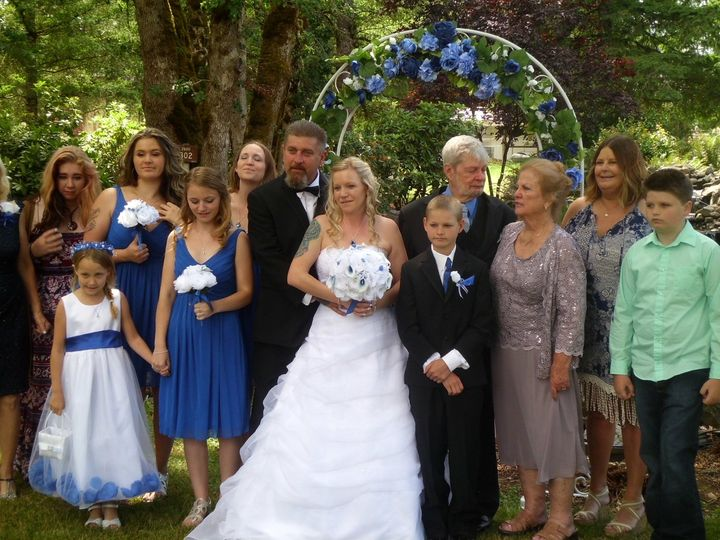 The bride and groom with family