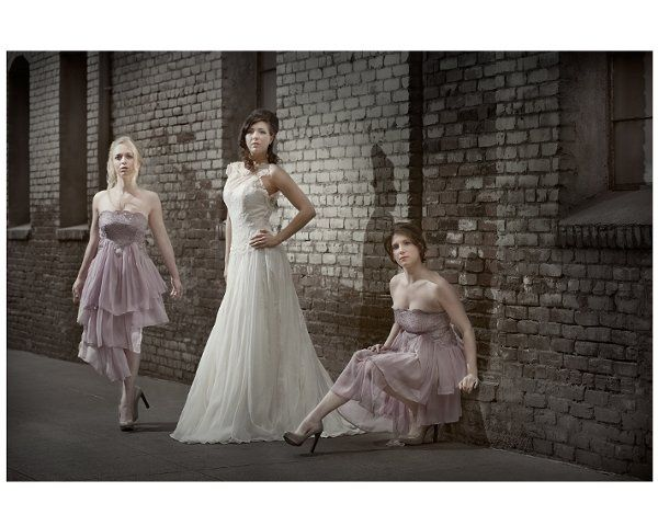 Bride: bateau neckline lace gown with layered skirt.  Bridesmaids: strapless beaded empire dress...