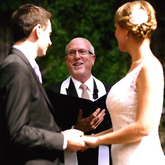 Rev Will officiating a wedding