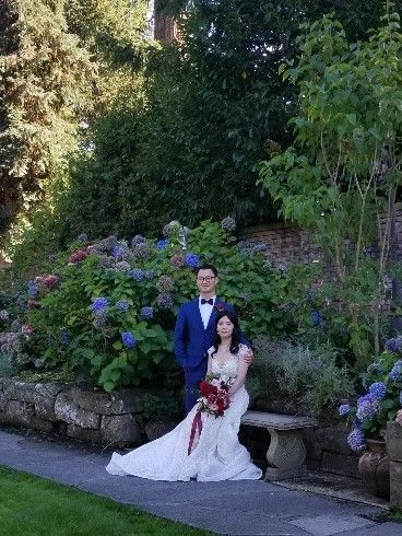Newlyweds by the garden