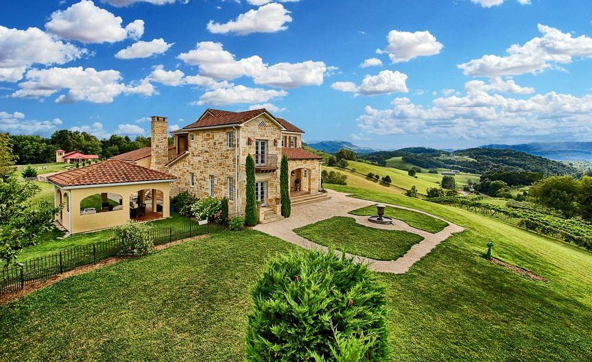 villa with vines blue skies 51 582066 161772397277790