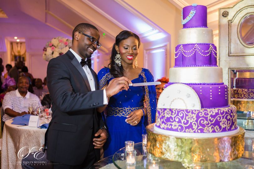 Couple cutting ornate cake