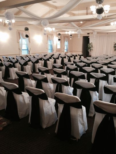 Ballroom set up for a ceremony for 130 guests