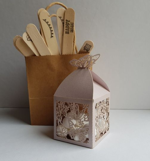 Butterfly favor boxes can be personalised with wording. Fillings vary or can be bought on its own.