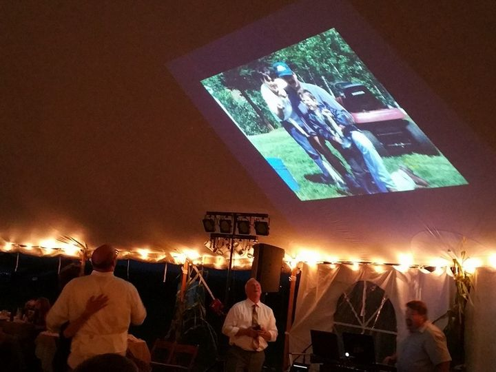 Slideshow on the ceiling of a tent