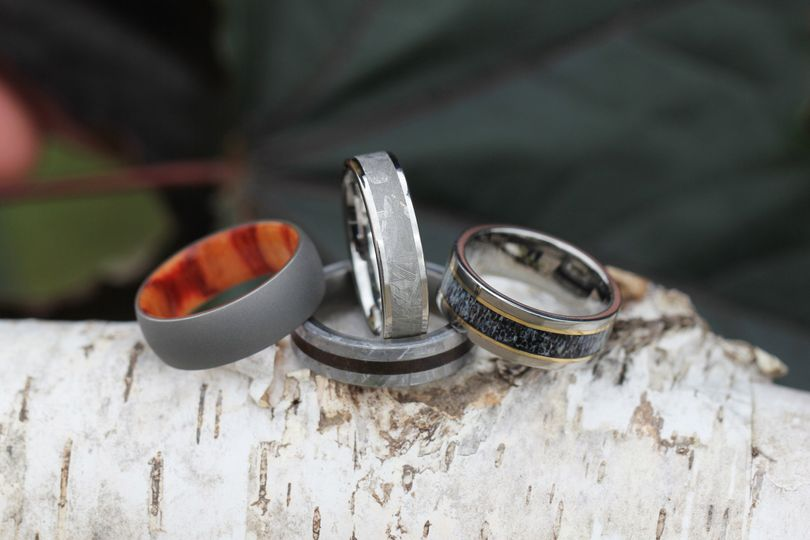 Unique wedding bands hand-crafted using natural elements. Shown left to right: Sandblasted Titanium...