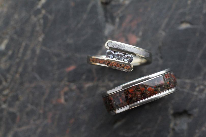Dinosaur Bone Wedding Band (SKU 2091) shown with Three Stone Moissanite Engagement Ring (SKU 2795)