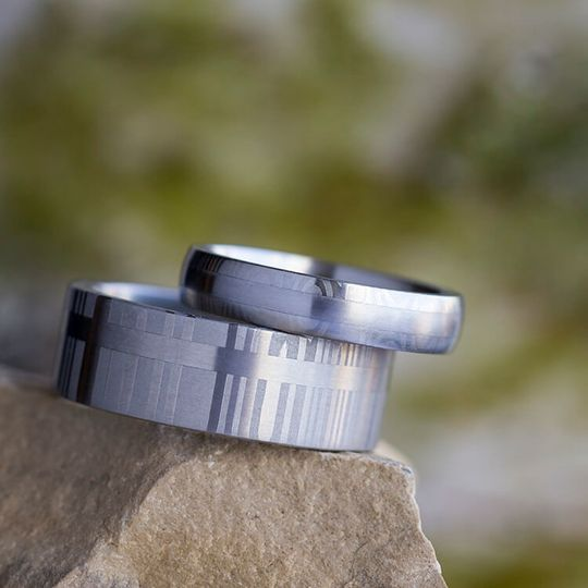 These matching wedding bands feature damascus steel patterns, with subtle and unique finish...