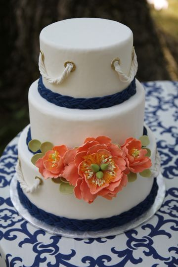 White Fondant Covered Tiers, With Fondant Braided Ropes, And Handcrafted Sugar Flowers