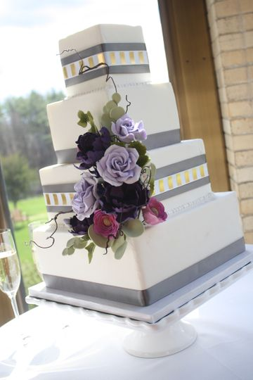 Modern Square Wedding Cake, Fondant Covering, Decorated With Ribbon And Handcrafted Sugar Flowers.