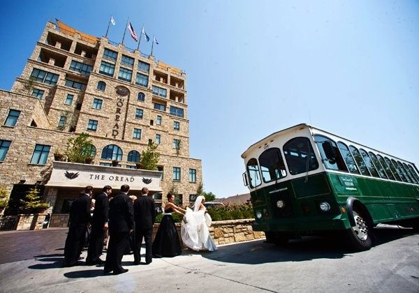 Newlyweds and guests about to ride the trolley