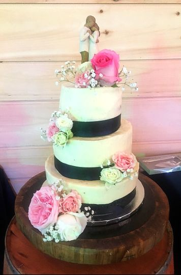Floral cake with black ribbons