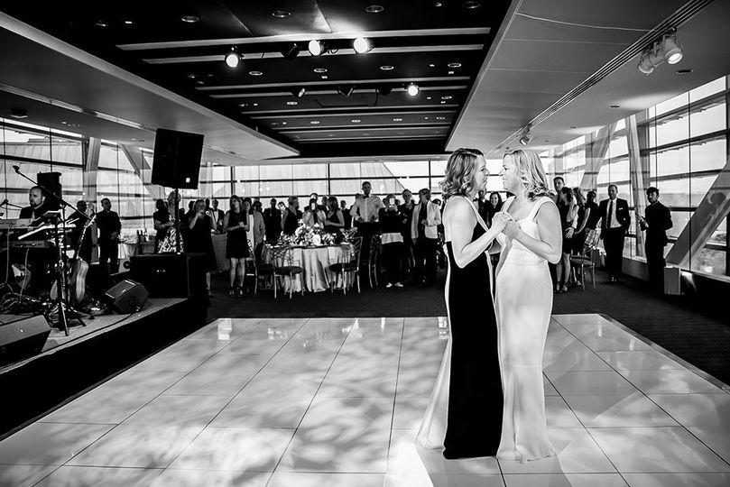 First dance romance on a shiny white acrylic dance floor.