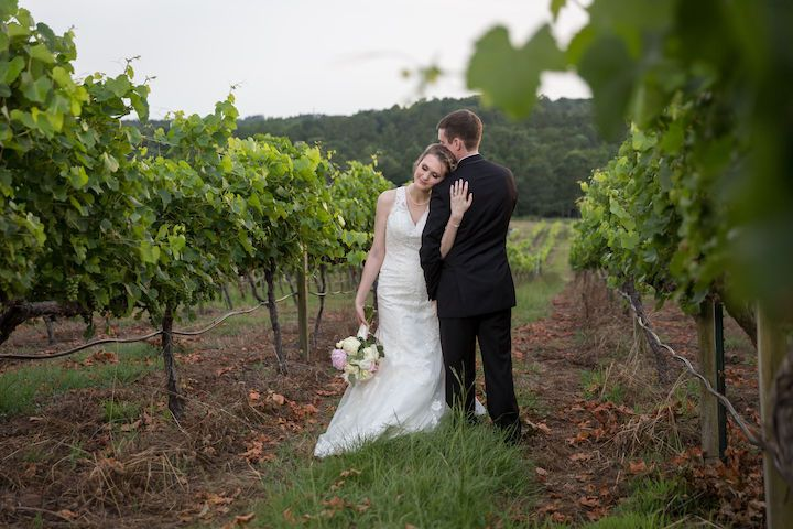 Madison & Dan at the beautiful venue, Enoch's Stomp Vineyard! Good times & great wine!