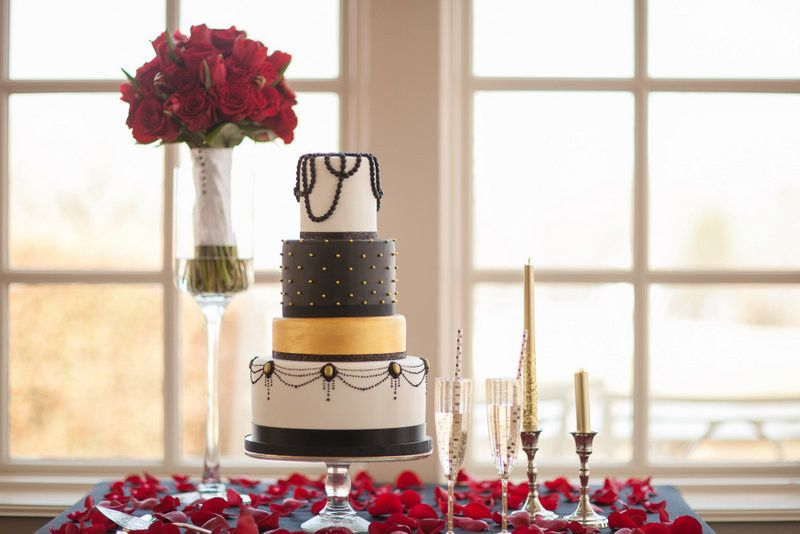 Art deco inspired wedding cake in white, black and gold.