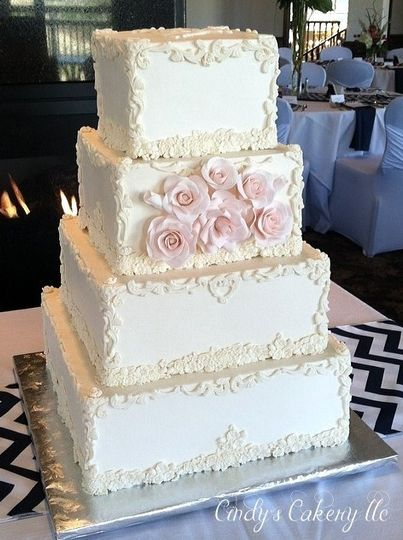 Baroque frame inspired square wedding cake with sugarpaste pink roses.