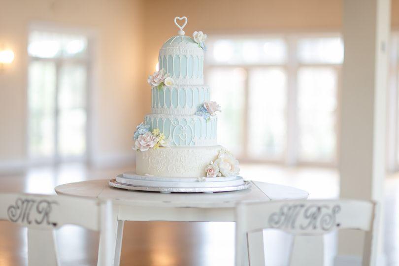 Birdcage inspired wedding cake with sugarpaste florals