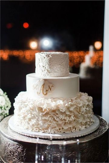Buttercream cake with fondant lace, petals and monogram plaque.