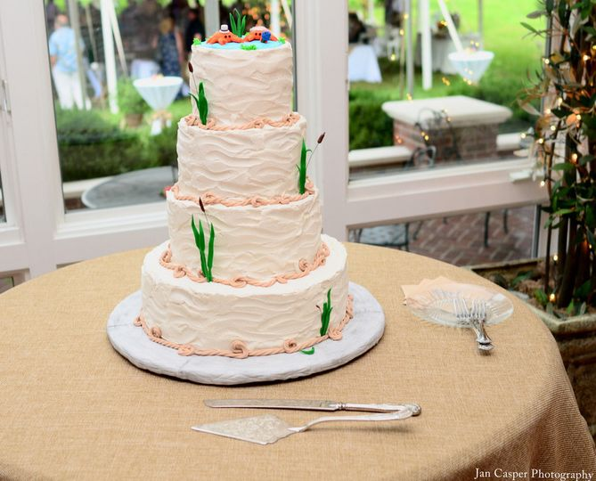 """""""Rivah"""" inspired wedding cake with buttercream wave textures, sugarpaste cattails and crab topper."""