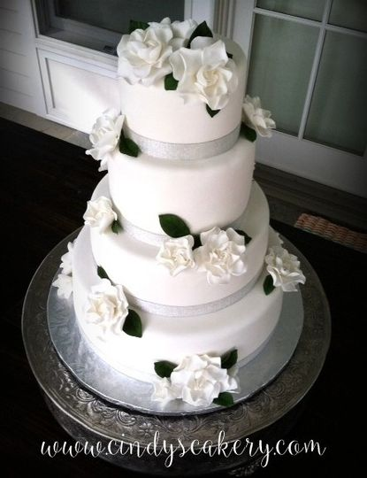 White fondant wedding cake with sugarpaste gardenias