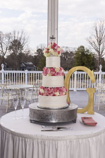 Buttercream Wedding cake with floral spacers and piped pearl drops