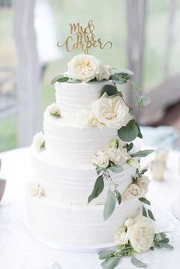 Fluted buttercream cake with fresh florals.