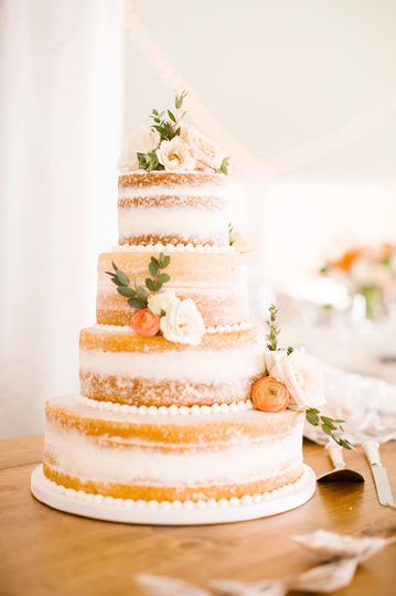 Sheer buttercream cake with piped pearls and fresh florals