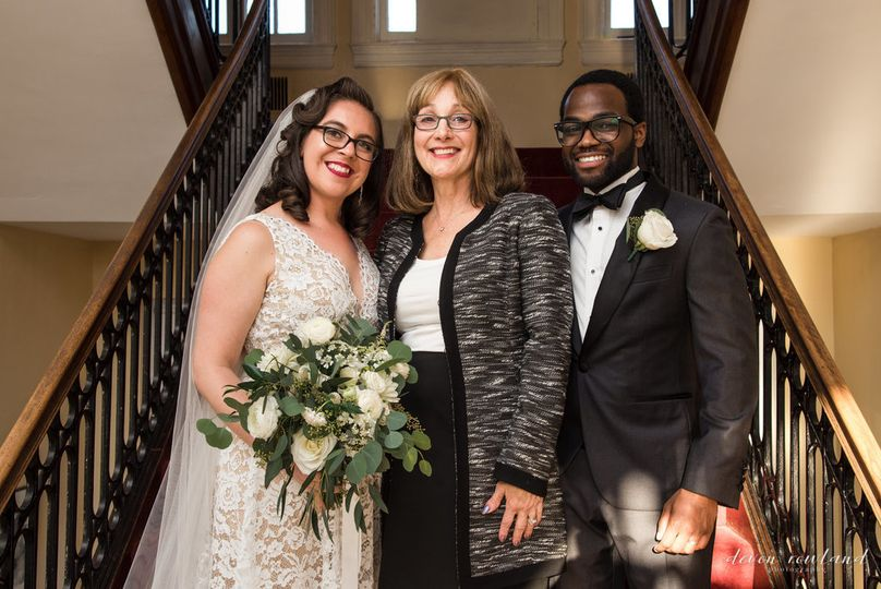 Bride, groom, and cantor