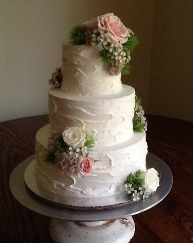 Textured white cake with flowers