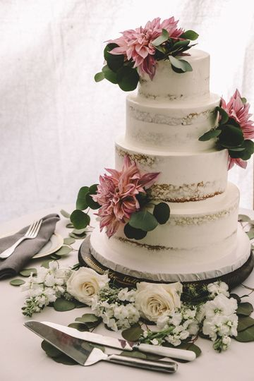 Naked cake with pink flower decor