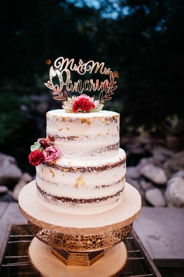 Naked wedding cake with text topper