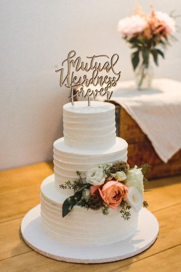 Textured cake with text topper