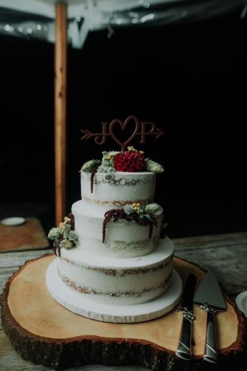 Naked cake with red flower topper