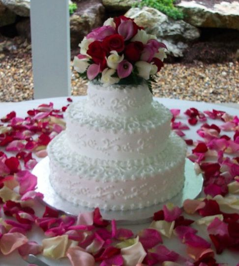 Served 120 guests, accented with a fresh floral cake top and surrounding by hundreds of rose petals.