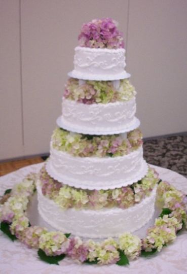 Served 200 guests. Tower cake set-up with hydrangea between each tier.