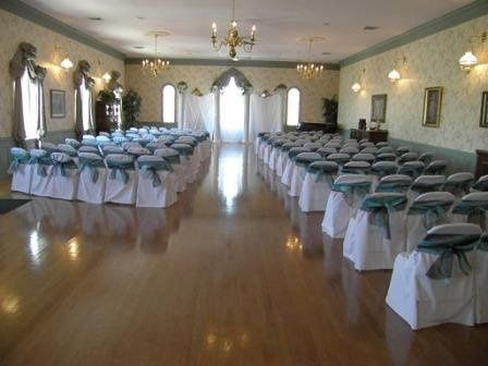 Hall set up for wedding, local vendors are available to rent chairs and chair covers.