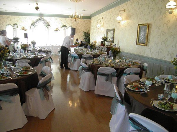Tables and chairs are provided.  This shows the room set up for a formal sit down meal.