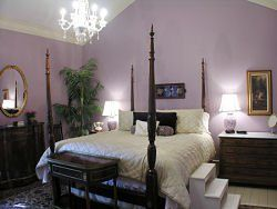 The honeymoon suite, kingsize 4 poster bed, jacuzzi tub, elegant antique furniture, in the old...