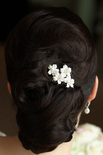 Small flowers tucked into low bun