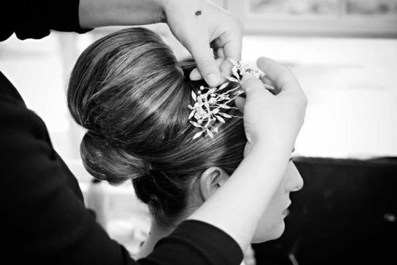 Stylist putting on hair ornament