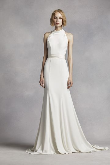 White by Vera Wang Style VW351263Stretch crepe sheath gown with high halter neckline, T-back,...