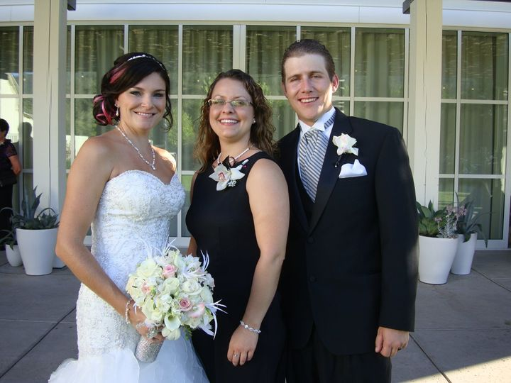 Newlywed couple and the wedding officiant